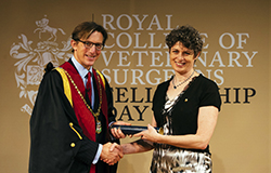 Dr Clare Rusbridge receiving her certificate of Fellowship from RCVS President Chris Tufnell