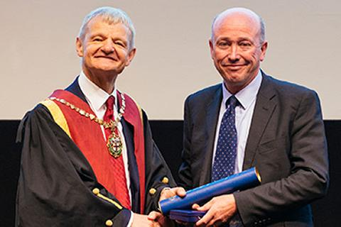 Peter Clegg receiving the Queen's Medal from former RCVS President Professor Stephen May