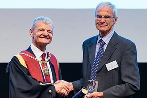 Derek Knottenbelt receiving the RCVS Inspiration Award from former RCVS President Professor Stephen May
