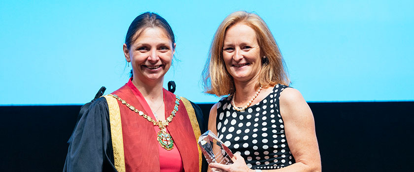 Prof Sarah Freeman receiving the Impact Award from RCVS President Amanda Boag