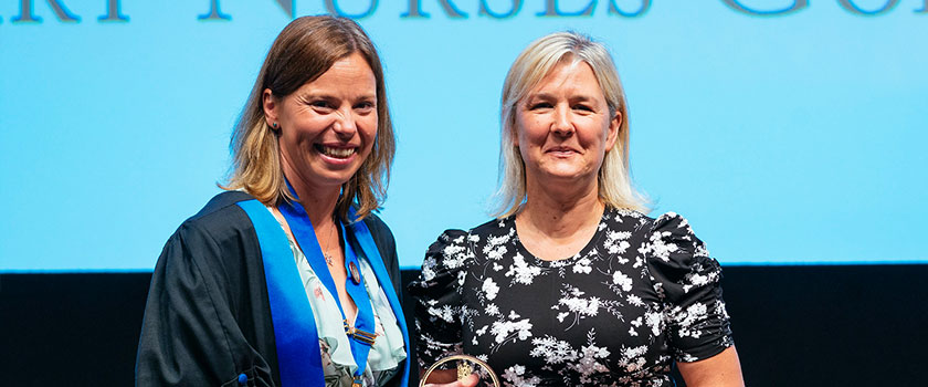 Jane Devaney RVN receiving the VN Golden Jubilee Award from VN Council Chair Racheal Marshall