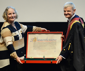 Judy MacArthur-Clark presenting Lord Soulsby's scroll to Stephen May Royal College Day 2018