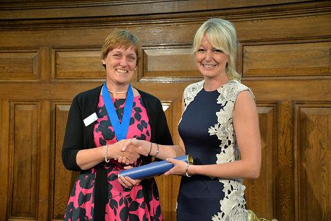 Kathy Kissick (left) presents Hayley Walters (right) with her Golden Jubilee Award at RCVS Day 2014